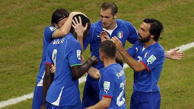Italy's Mario Balotelli (2nd L) is congratulated by teammates after scoring against Japan during their Confederations Cup Group A soccer match at the Arena Pernambuco in Recife June 19, 2013. (Reuters)