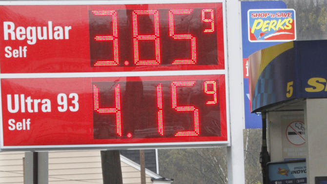 A man fuels a vehicle at a gas station, Friday, April 22, 2011 in Millvale, Pa. With gas prices above $4 in some states, Americans are canceling spring break plans and rethinking summer vacation, and some tourist destinations are offering gas vouchers of as much as $50 to talk people out of giving up and staying home.(AP Photo/Keith Srakocic)