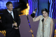 "Daniel Junge and Sharmeen Obaid-Chinoy accept the Oscar for best documentary short for ""Saving Face"" during the 84th Academy Awards on Sunday, Feb. 26, 2012, in the Hollywood section of Los Angeles. (AP Photo/Mark J. Terrill)"