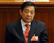Former Chongqing Party Secretary Bo Xilai, seen during the closing ceremony of the National People&#39;s Congress at the Great Hall of the People in Beijing, in March. The charismatic Bo had been widely expected to ascend to the all-powerful nine-man Communist Party committee that runs China later this year but was ousted recently in a scandal that has shaken Chinese politics to its core