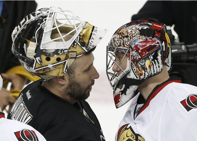 Penguins goalie Vokoun is congratulated by Senators goalie Anderson after the Penguins eliminated the Senators in their NHL Eastern Conference semi-final hockey series in Pittsburgh
