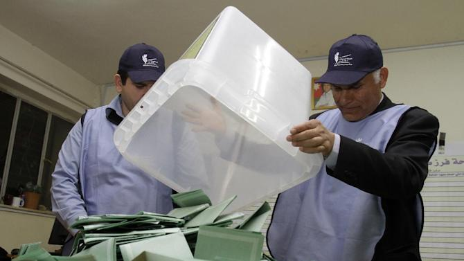 Jordanian election officials empty ballot boxes to begin counting the votes after polling stations closed, in Amman Wednesday  Jan. 23, 2013. Jordanians voted on Wednesday in their first parliamentary elections since the Arab Spring revolts, but a boycott by the main Islamist party will ensure no repeat of an Egypt-style revolution via the ballot box. (AP Photo/Raad Adayleh)