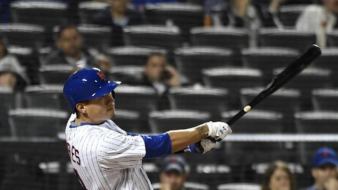New York Mets' Wilmer Flores hits a two-run home run off of Miami Marlins starting pitcher Jose Urena in the sixth inning of a baseball game at Citi Field on Saturday, April 18, 2015, in New York. (AP Photo/Kathy Kmonicek)