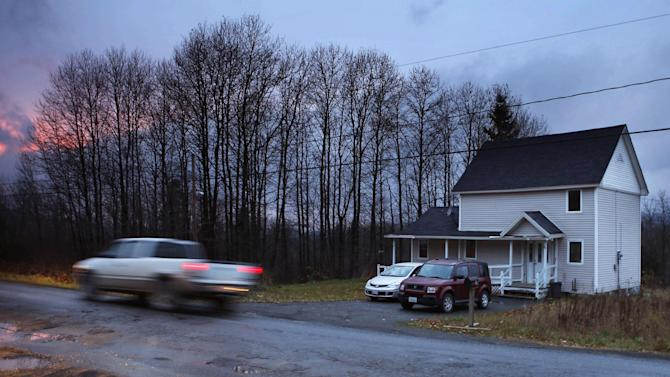 A truck passes the rural home Wednesday, Oct. 29, 2014, in Fort Kent, Maine, where Kaci Hickox, a nurse who treated Ebola patients in West Africa, is staying. Hickox said Wednesday she plans to stop quarantining herself in rural Maine, signaling a potential showdown with state police monitoring her home and state officials preparing to legally enforce the quarantine. She said she'll defy the state if the policy isn't changed by Thursday. (AP Photo/Robert F. Bukaty)