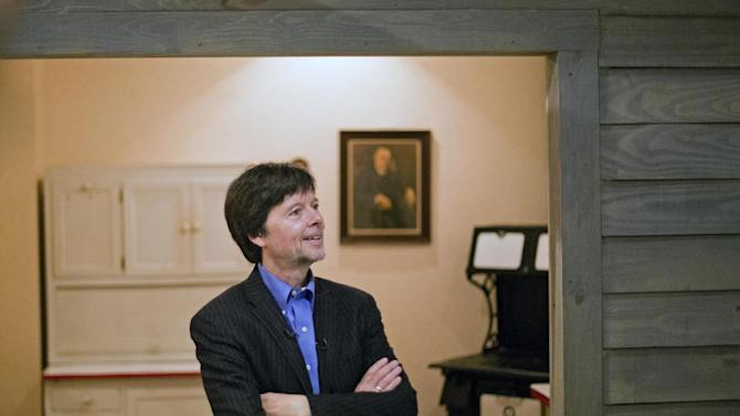 """FILE - In this Nov. 2, 2013 file photo, documentary filmmaker Ken Burns walks through the museum at the Georgia home used by former President Franklin D. Roosevelt in Warm Springs, Ga. FDR, first lady Eleanor Roosevelt and another Roosevelt who occupied the White House as president, Theodore Roosevelt, are the subjects of a new Burns documentary for public television, """"The Roosevelts: An Intimate History."""" Burns' series """"The Roosevelts"""" earned PBS its biggest audience in two decades, making it the documentary maker's third most popular film after """"The Civil War"""" and """"Baseball."""" PBS said the seven, two-hour episodes that aired last month had an average audience of 9.2 million viewers. The most popular was the first night, on Sept. 14, which had 11.7 million viewers, according to the Nielsen company. (AP Photo/David Goldman, File)"""