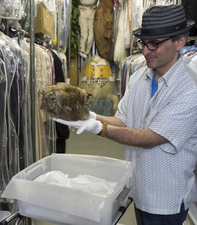 "In this Friday, Nov. 30, 2012 photo, James Comisar shows Fess Parker's ""Daniel Boone"" coonskin hat worn in the late 1960s television show. The item is part of his television memorabilia collection in a temperature- and humidity-controlled warehouse in Los Angeles. (AP Photo/Damian Dovarganes)"