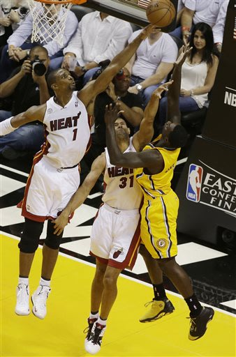 Miami Heat center Chris Bosh (1) blocks a shot to the basket by Indiana Pacers guard Lance Stephenson (1) as Heat forward Shane Battier (31) defends during the first half of Game 2 in their NBA basket