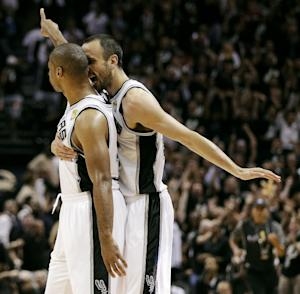 San Antonio Spurs' Gary Neal celebrates a 3-point basket at the first-half buzzer with teammate Manu Ginobili during Game 3 of their NBA Finals basketball series against the Miami Heat, Tuesday, June 11, 2013, in San Antonio. (AP Photo/Eric Gay)