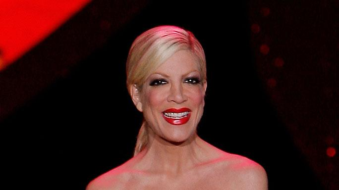 Tori Spelling walks the runway wearing Betsey Johnson at the Heart Truth Red Dress Collection Fall 2009 fashion show during Mercedes-Benz Fashion Week at The Tent in Bryant Park on February 13, 2009 in New York City.