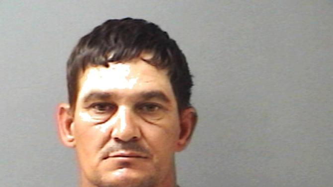 This booking photo provided by the The Hopkins County Sheriff's Office shows Brian Allen Tucker. On Tuesday, April 2, 2013,  Tucker, an inmate awaiting trial on a capital murder charge in a 2011 slaying and another prisoner, John Marlin King, broke out of the Hopkins County Jail. (AP Photo/The Hopkins County Sheriff's Office)