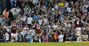 West Ham United's Ravel Morrison celebrates with team mate Ricardo Vaz Te after scoring against Tottenham Hotspur during their English Premier League soccer match in London