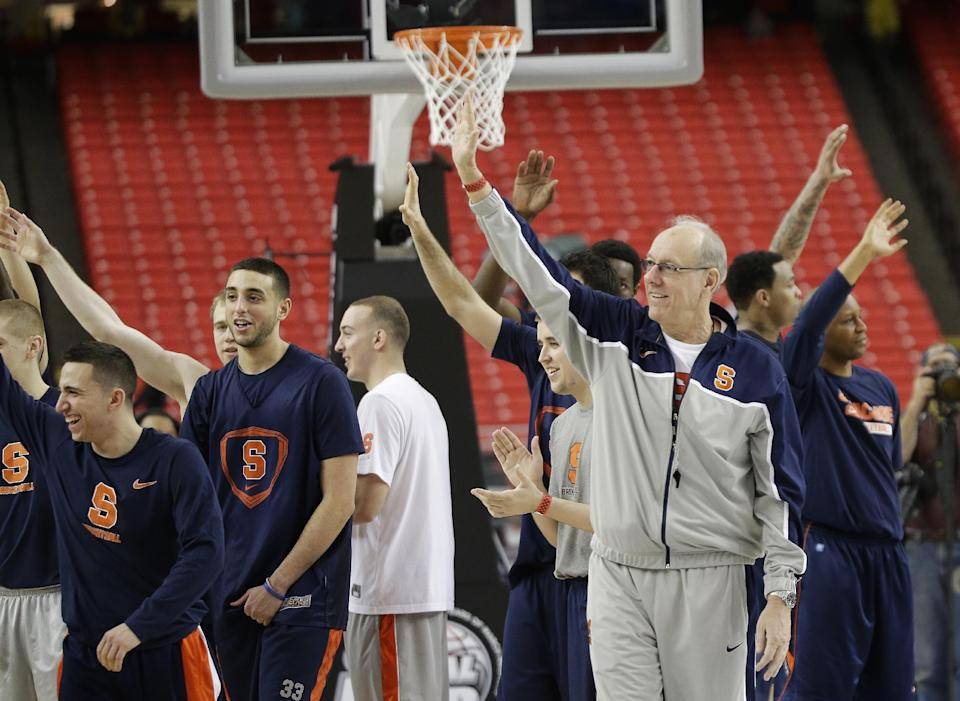 Syracuse players leave the court after practice of the NCAA Final Four tournament college basketball semifinal game Friday, April 5, 2013, in Atlanta. Syracuse plays Michigan in a semifinal game on Saturday. (AP Photo/David J. Phillip)
