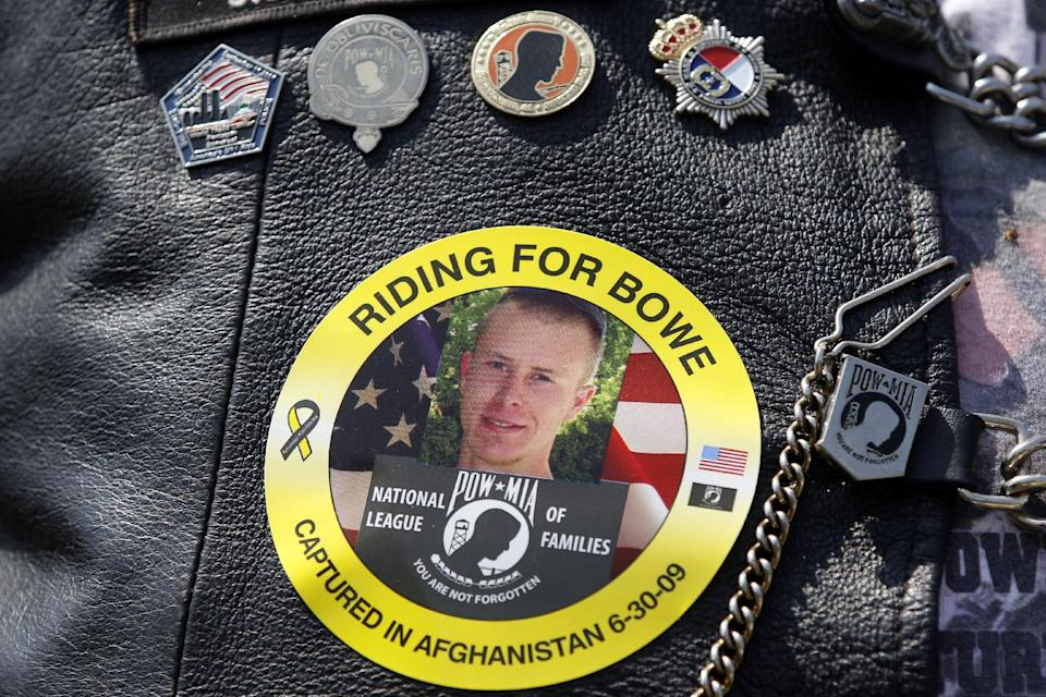 The image of Army Sgt. Bowe Bergdahl of Hailey, Idaho, who is being held captive in Afghanistan, is worn by an audience member as he father Bob, not pictured, speaks at the the annual Rolling Thunder rally for POW/MIA awareness, in Washington, Sunday, May 27, 2012. (AP Photo/Charles Dharapak)