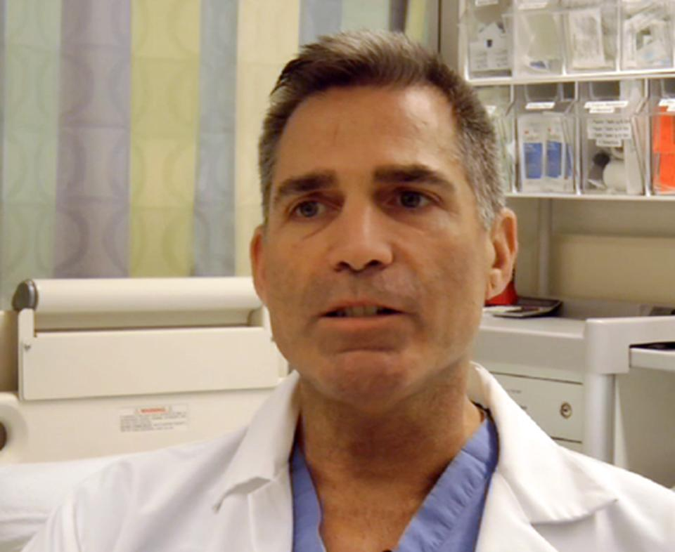 In this frame grab from Saturday, April 20, 2013, video, Massachusetts General Hospital nurse Adam Barrett talks about the horrific early hours as bloody patients poured in after the explosions at the Boston Marathon. (AP Photo/Carla K. Johnson)