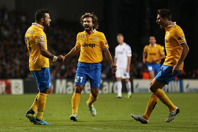 Juventus' Fabio Quagliarella, left, celebrates his equalizing goal with teammates Andrea Pirlo, center, and Federico Peluso, during their Champions League Group B soccer match against FC Copenhagen at