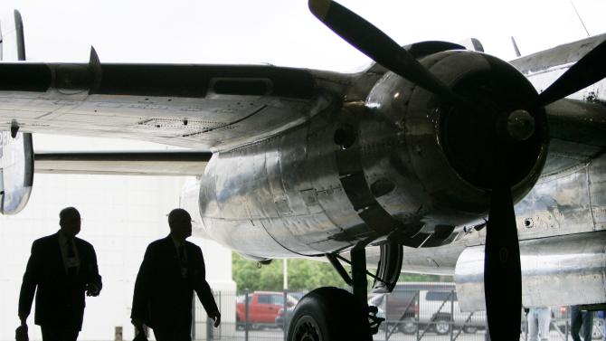 FILE - In this April 17, 2007 file photo, Doolittle Raiders Dick Cole, left, and Dave Thatcher walk past the B-25 Bomber, named Pacific Prowler, as they arrive for a ceremony at Randolph Air force Base in San Antonio. The Doolittle Raiders are celebrating the 70th anniversary of their 1942 raid on Japan April 17-20, 2012, in Dayton, Ohio. (AP Photo/Eric Gay, File)