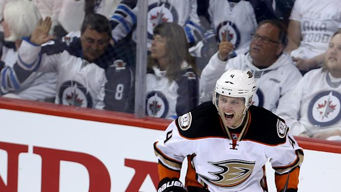Anaheim Ducks' Cam Fowler (4) celebrates after scoring against the Winnipeg Jets' during the first period of game three NHL playoff hockey action in Winnipeg, Monday, April 20, 2015. (Trevor Hagan/The Canadian Press via AP)   MANDATORY CREDIT