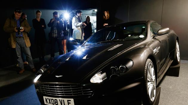 The 2008 Aston Martin 6 litre V12 DBS 2 door coupe used by Daniel Craig as James Bond in the movie 'Quantum of Solace' is shown to the media during a press preview at the James Bond movie memorabilia charity auction. The car is expected to sell for some 100,000 -150,000 British pounds ($160-230,000 euro 120-170,00) with the proceeds going to the British children's charity Barnardo's.