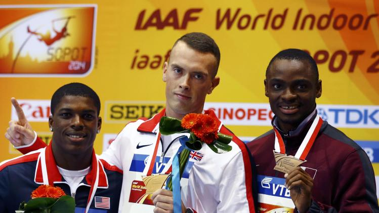 Medallists Bracy of U.S.Britain's Kilty and Qatar's Ogunode celebrate during victory ceremony for men's 60m at world indoor athletics championships in Sopot