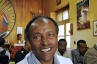 Chief buyer of Tomoca coffee, Akalu Woube, poses in Addis Ababa at his cafe on May 28, 2013. Akalu buys coffee from the Ethiopian Commodities Exchange