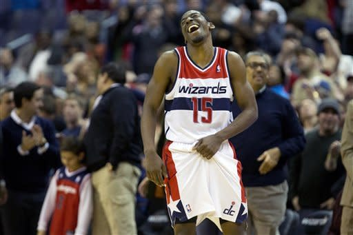 Wizards end 8-game skid, top slumping Magic 105-97