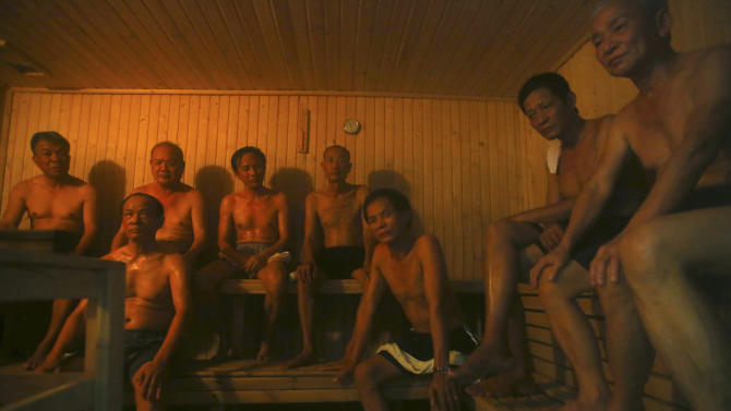 In this photo taken on March 18, 2013, patients sit in a sauna room at the Scientology Health Center of the Vietnam Association of Agent Orange Victims in Thai Binh, Vietnam. The center runs a 25-day health program which, as well as massive consumption of vitamins, includes four-hour sauna sessions and a morning run. While there is no medical evidence that the treatment at the center is effective, Vietnamese authorities are supporting it as a way of relieving some of the suffering of the between 2 and 4 million people suffering from illnesses linked to exposure to Agent Orange during the war. (AP Photo/Na Son Nguyen)