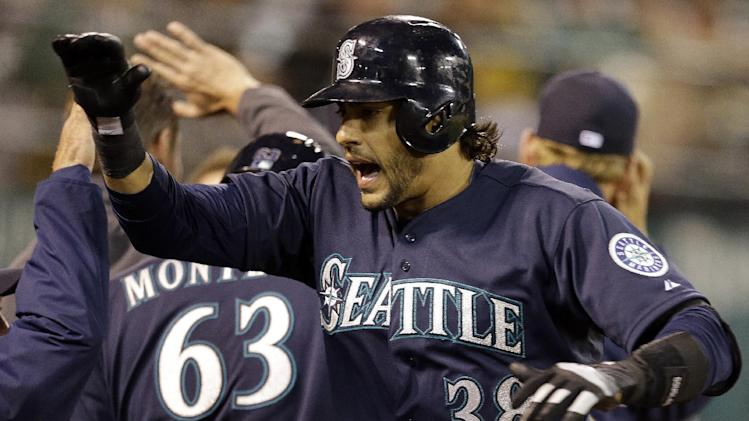 Seattle Mariners' Michael Morse (38) celebrates after hitting a home run off Oakland Athletics' Grant Balfour in the ninth inning of a baseball game Tuesday, April 2, 2013, in Oakland, Calif. (AP Photo/Ben Margot)