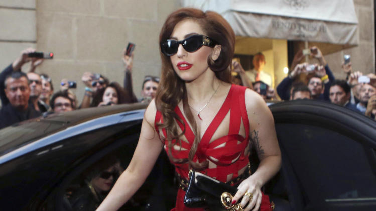 FILE - In this Monday, Oct. 1, 2012, file photo, Lady Gaga arrives at the Versace atelier in Milan, Italy. YouTube is launching its own music awards and Lady Gaga will perform at the first-time event. The Google Inc.-owned company announced Tuesday, Oct. 1, 2013, that Eminem and Arcade Fire also will perform at the YouTube Music Awards on Nov. 3. It will take place at Pier 36 in New York City and stream live online. (AP Photo/Luca Bruno, File)