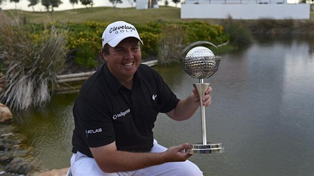 Irish golfer Shane Lowry poses with his trophy after his victory in the Portugal Masters golf tounament at Victoria Golf Course in Vilamoura