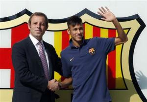 File photo of Brazilian soccer player Neymar shakes hands with Barcelona's president Rosell after signing a five-year contract with FC Barcelona