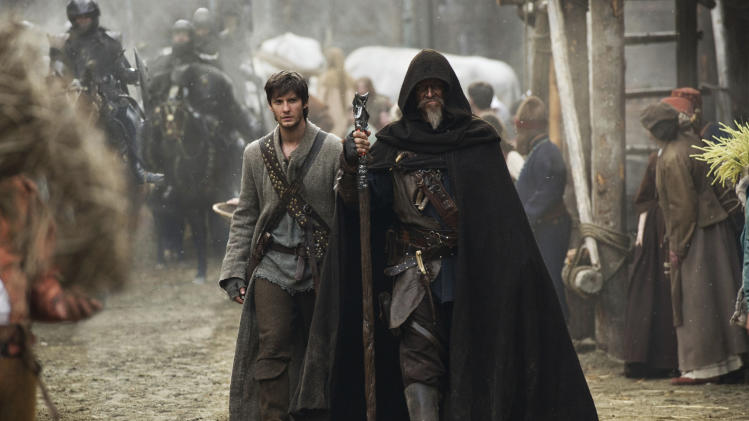 "This undated publicity photo released by courtesy Warner Bros. Pictures, shows Ben Barnes, left, as Tom Ward, and Jeff Bridges, as Master Gregory, in Warner Bros. Pictures' and Legendary Pictures' fantasy action adventure film, ""Seventh Son,"" a Warner Bros. Pictures release. China's state-owned film distributor is making its first investment in Hollywood movies by taking a stake in two Legendary Entertainment productions. China Film Co. will make an ""eight-figure equity investment"" in two upcoming films, ""Seventh Son"" and ""Warcraft,"" the Chinese unit of Legendary Entertainment said Tuesday, April 15, 2014. (AP Photo/Warner Bros. Pictures/Legendary Pictures, Kimberly French) NO SALES"
