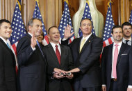 """<p>               FILE - In this Jan. 3, 2013, file photo, Rep. Trent Franks, R-Ariz., center right, stands with his family for a ceremonial photo with Speaker of the House John Boehner, R-Ohio, center left, in the Rayburn Room of the Capitol after the new 113th Congress convened in Washington. The nation's sharp disagreements over taxes and spending are on a re-routed collision course, as Senate Democrats launch a plan that includes new taxes, and House Republicans vow to speed up their plan to balance the federal budget with spending cuts alone. """"The American people will have a chance to compare the two approaches,"""" said Franks, who wants deep spending cuts and no new taxes. The only way to shrink the government, he said, """"is to choke the monster.""""  (AP Photo/J. Scott Applewhite, File)"""