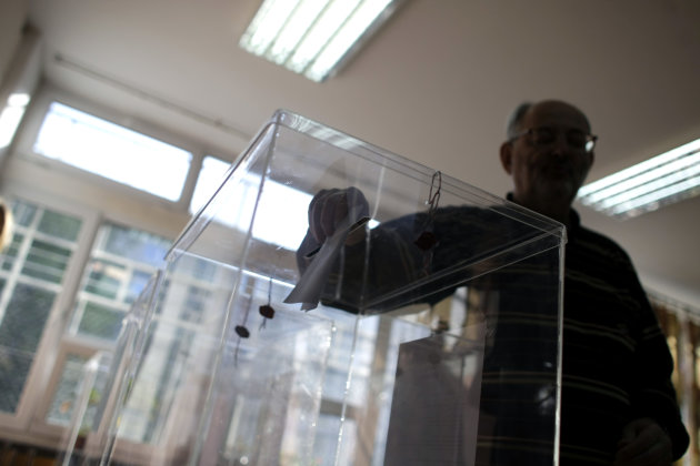 A man casts his ballot at a polling station during the elections in Belgrade, Serbia, Sunday, May 6, 2012. Serbia, a landlocked nation of 7.1 million people in southeast Europe, is holding presidentia