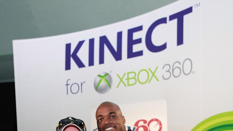 Gary Stein and NFL running back Adrian Peterson and Duke Stein at Kinect for Xbox 360, on Thursday, Jan. 31, 2013 in New Orleans, LA. (Photo by Barry Brecheisen/Invision for Xbox/AP Images)