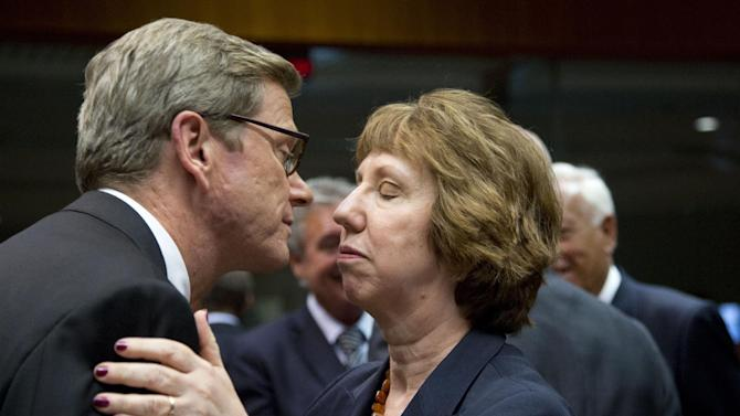 German Foreign Minister Guido Westerwelle, left, greets European Union Foreign Policy Chief Catherine Ashton, right, during an emergency meeting of EU foreign ministers at the EU Council building in Brussels on Wednesday, Aug. 21, 2013. EU foreign ministers are seeking to forge a joint response to the crisis in Egypt by looking for ways to end the violence and return to negotiations. (AP Photo/Virginia Mayo)