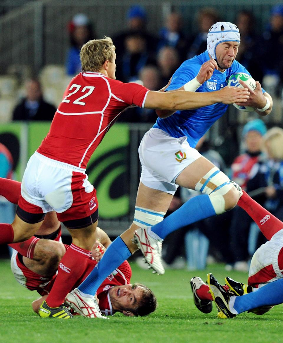 Italy's Cornelius van Zyl brushes, right, off Russia's Yury Kushnarev during their Rugby World Cup pool match at Trafalgar Park, Nelson, New Zealand, Tuesday, Sept. 20, 2011.   (AP Photo/SNPA, Ross Setford) NEW ZEALAND OUT
