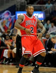 Chicago Bulls point guard Nate Robinson (2) celebrates a three-pointer in the first half of an NBA basketball game against the Atlanta Hawks, Saturday, Dec. 22, 2012, in Atlanta. (AP Photo/Todd Kirkland)