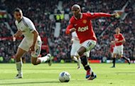 Manchester United midfielder Ashley Young (R) and Swansea City's Steven Caulker during their Premier League match against Swansea City on May 6. Four minutes before the break United had a second when Young's low strike beat Swansea goalkeeper Michel Vorm