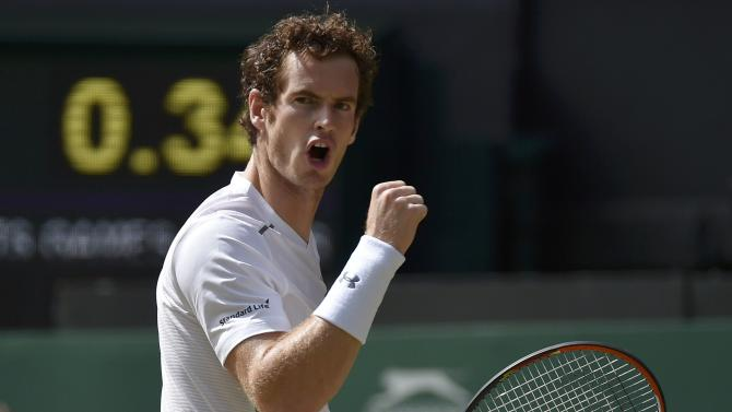 Andy Murray of Britain reacts during his match against Ivo Karlovic of Croatia at the Wimbledon Tennis Championships in London
