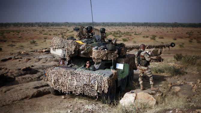 French soldiers man a Sagaie tank at an observation post outside Sevare, some 620 kms (400 miles)  north of Mali's capital  Bamako Thursday, Jan. 24, 2013.  One wing of Mali's Ansar Dine rebel group has split off to create its own movement, saying that they want to negotiate a solution to the crisis in Mali, in a declaration that indicates at least some of the members of the al-Qaida-linked group are searching for a way out of the extremist movement in the wake of French airstrikes. (AP Photo/Jerome Delay)