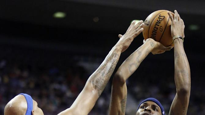 Charlotte Bobcats forward Tyrus Thomas (12) takes a shot against Detroit Pistons forward Charlie Villanueva (31) in the first half of an NBA basketball game, Sunday, Jan. 6, 2013, in Auburn Hills, Mich. (AP Photo/Duane Burleson)