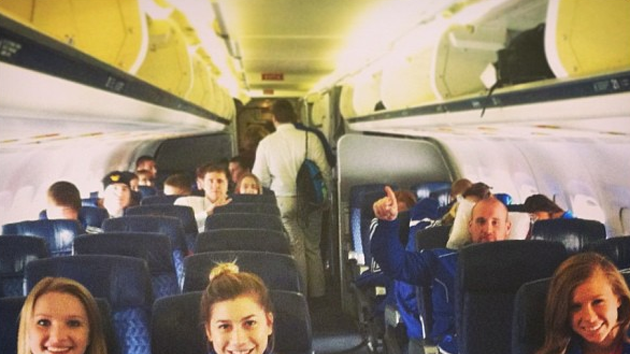 8 Cheerleaders from Kansas University prefer track suits when they fly.