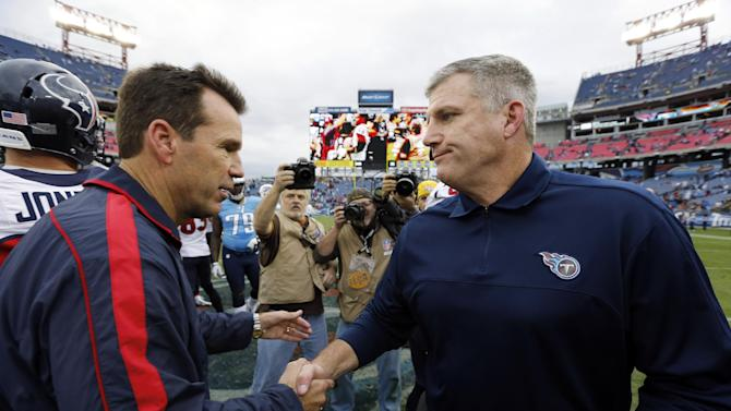 Tennessee Titans head coach Mike Munchak, right, congratulates Houston Texans head coach Gary Kubiak, left, after the Texans' 24-10 win in an NFL football game, Sunday, Dec. 2, 2012, in Nashville, Tenn. With the win, the Texans clinched their second straight playoff berth, a franchise-record 11th win this season, and their first season sweep of The Titans. (AP Photo/Joe Howell)