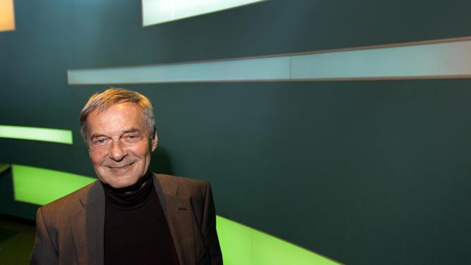 Erno Rubik, the inventor of the Rubik's Cube, poses for The Associated Press at Liberty Science Center, Wednesday, April 25, 2012, in Jersey City, N.J. The center is hosting an exhibit on Rubik's Cubes which will include a cube made with diamonds that is worth 2.5 million dollars. (AP Photo/Julio Cortez)