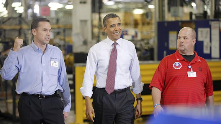 "President Barack Obama walks with Plant Manager and Vice President of Operations Jeff Allen, left, and UAW NW Local 163 Detroit Diesel Engine Unit Shop Chairperson Mark ""Gibby"" Gibson, right, during a visit to the Daimler Detroit Diesel plant in Redford, Mich., Monday, Dec. 10, 2012. (AP Photo/Charles Dharapak)"