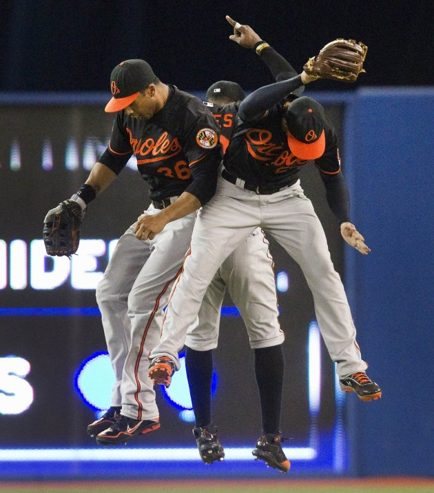 Baltimore Orioles outfielders Jones, Dickerson and Markakis celebrate beating the Toronto Blue Jays during their MLB American League baseball game in Toronto