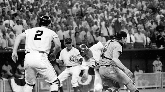 THIS CORRECTS THAT DUROCHER IS THE MANAGER OF THE CHICAGO CUBS, NOT THE REDS, AND THAT DIETZ PLAYS FOR THE SAN FRANCISCO GIANTS, NOT THE REDS - FILE - In this July 14, 1970 file photo, Cincinnati Reds' Pete Rose (14) slams into Cleveland Indians' catcher Ray Fosse to score a controversial game-winning run for the National League team in the 12th inning of the 1970 All-Star game in Cincinnati. Fosse suffered a fractured shoulder in the collision. Looking on are NL coach Leo Durocher, manager of the Chicago Cubs, and on-deck batter Dick Dietz (2), of the San Francisco Giants. Major League Baseball plans to eliminate home plate collisions, possibly as soon as next season but no later than by 2015. New York Mets general manager Sandy Alderson, chairman of the rules committee, made the announcement Wednesday, Dec. 11, 2013 at the winter meetings. Player safety and concern over concussions were major factors in the decision. (AP Photo/File)