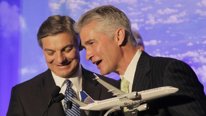 United Airlines CEO Jeff Smisek accepts a a model of Boeing's new 737 Max 9 from Boeing Commercial Airplanes CEO Ray Conner, left, during a news conference, Thursday, July 12, 2012, in Chicago. United Airlines and Boeing announced that United is buying 150 Boeing 737s, and is planning to use them to replace older planes that are not as fuel efficient.(AP Photo/M. Spencer Green)