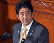 Japanese Prime Minister Shinzo Abe answers questions during a parliamentary session at the National Diet in Tokyo, on January 31, 2013. Abe has demanded Beijing apologise and admit that a Chinese frigate got a radar lock on a Japanese destroyer in international waters, according to local media reports