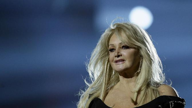 """Bonnie Tyler of Britain performs her song """"Believe in Me"""" during a rehearsal for the final of the Eurovision Song Contest at the Malmo Arena in Malmo, Sweden, Friday, May 17, 2013. The contest is run by European television broadcasters with the event being held in Sweden as they won the competition in 2012, the final will be held in Malmo on May 18. (AP Photo/Alastair Grant)"""